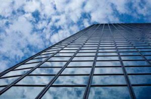 Tinted glass building photographed from below while looking up